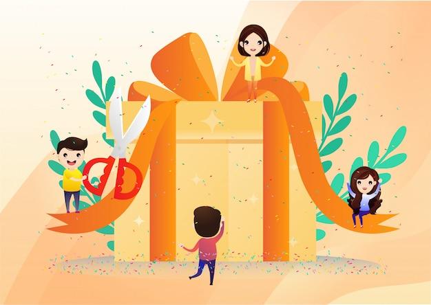 행복 웃는 사람들이 큰 선물 상자를 들고있다