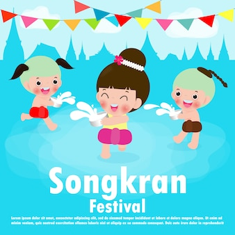 Happy songkran festival, kids enjoy splashing water in songkran festival