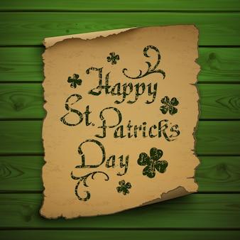 ハッピー聖パトリックの日は、古いスクロールと緑の木製の板に書道書体を描画します。