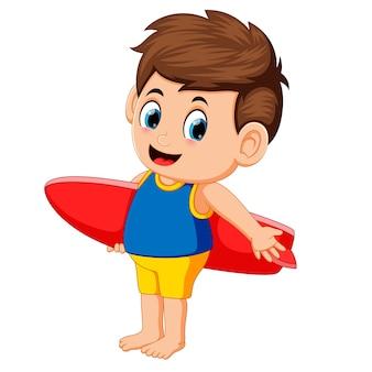 Happy surfer man is holding surfboard