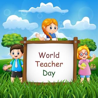 子供たちと一緒にサインの幸せな先生の日