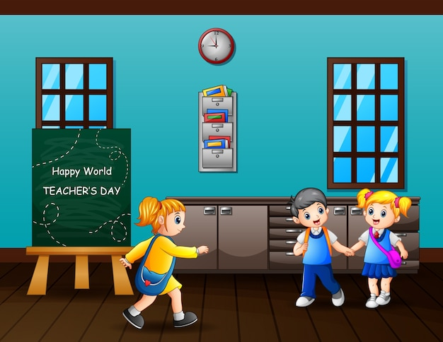 Happy teacher's day text on chalkboard with kids in the classroom