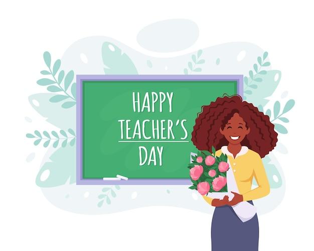 幸せな教師の日教室で花を持つ黒人女性教師