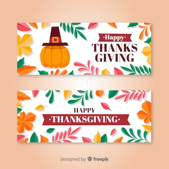 Happy thanksgiving banner set in flat design with autumn leaves and pumpkin
