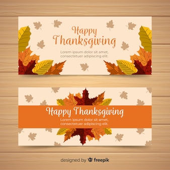Happy thanksgiving banner set in flat design with autumn leaves