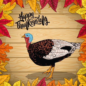 Happy thanksgiving. border from autumn leaves on wooden background. turkey illustration.  element for poster, emblem, , card.  illustration