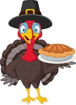 パイを握っているトルコの幸せな感謝のカード