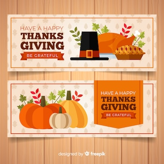 Happy thanksgiving day banner set with food and pumpkins