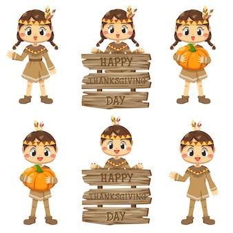 Icone felici di giorno del ringraziamento con ragazze e segni di legno vario.