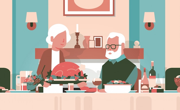 Happy thanksgiving elderly couple sitting table celebrating thanks day