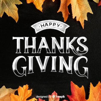 Happy thanksgiving lettering with dried canadian leaves