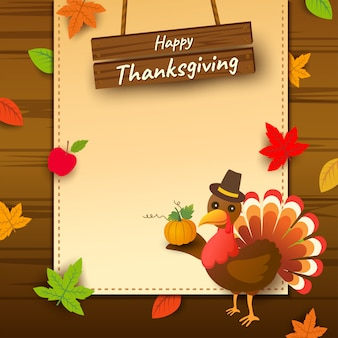 Happy thanksgiving with turkey bird and autumn leaf on wood background.