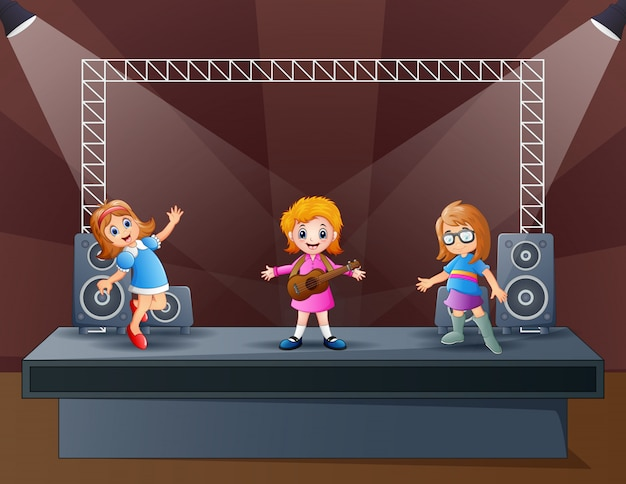 Happy three girls performing on the stage