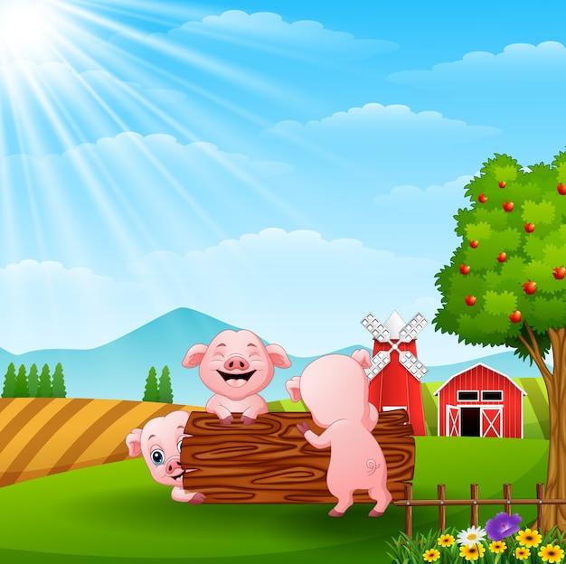 幸せな3つの小さな豚は、農場でログを再生する