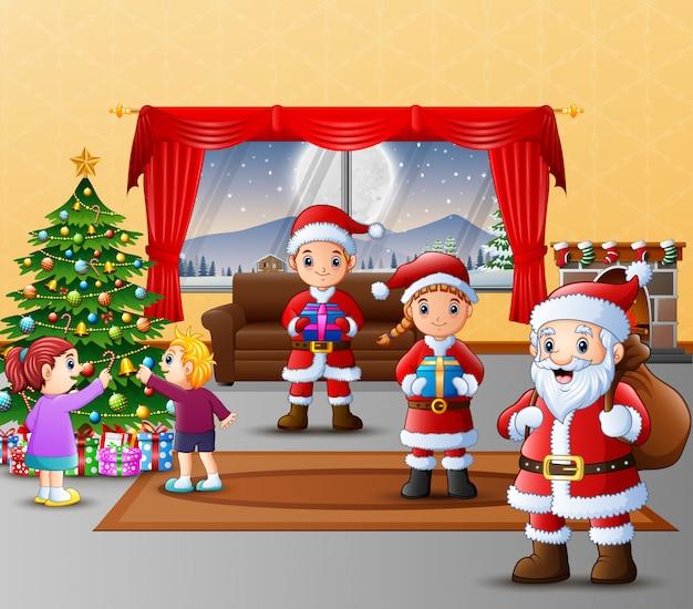 Happy three santa claus with kids decorating christmas tree