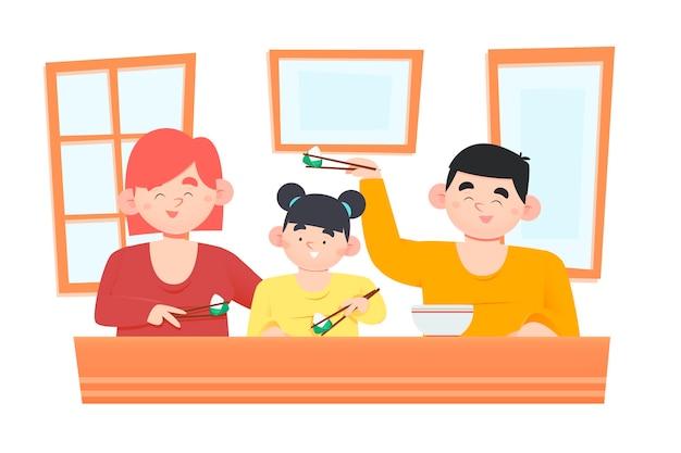 Famiglia tradizionale felice che mangia zongzi