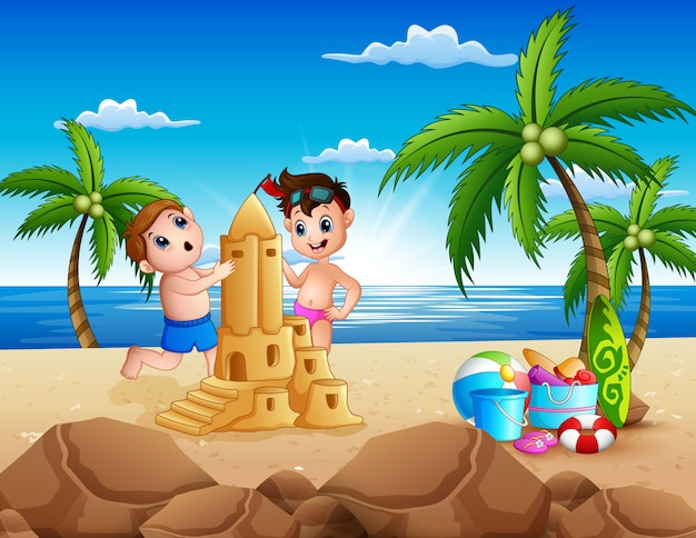 Happy two boys making sand castle on the beach