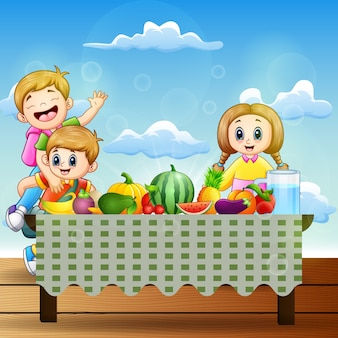 Happy two children with dishes of many kinds of fruits