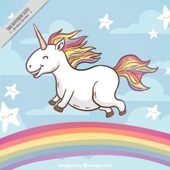Happy unicorn on a rainbow background