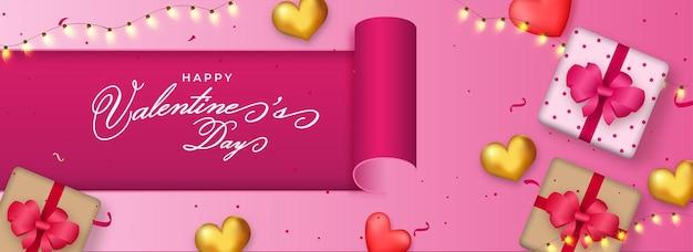 분홍색 배경에 선물 상자, 하트와 조명 갈 랜드의 상위 뷰와 함께 해피 발렌타인 데이 개념.