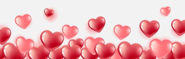 С днем святого валентина. гелевые шары-сердечки красные и розовые. горизонтальный баннер с местом для текста