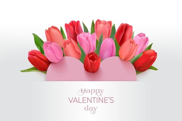 ピンクの写実的なチューリップと幸せなバレンタインデーのグリーティングカード。