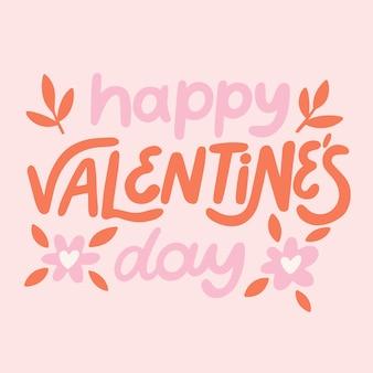 ピンクの背景に幸せなバレンタインデーのレタリング