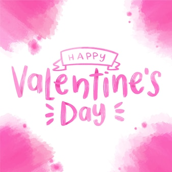 Happy valentine's day lettering with pink watercolor stains