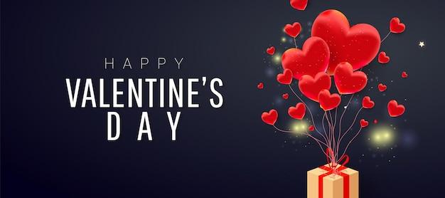 С днем святого валентина форма любви, летающая бумажная подарочная коробка и текст на темном фоне.