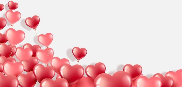 С днем святого валентина. реалистичные красные и розовые сердечные шары.