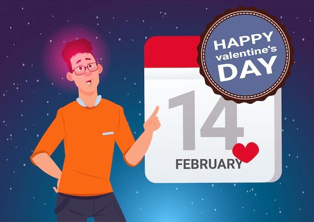 幸せなバレンタインデーコンセプトバナーカレンダーを保持している若い男ページ14 2月