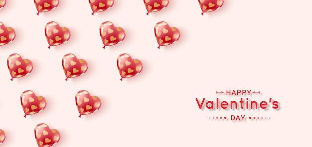 С днем святого валентина. летающие гелевые шары красного и розового цветов в узоре из золотых сердечек.