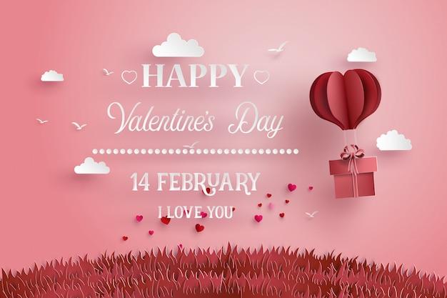 幸せなバレンタインの日グリーティングカード。 2月14日。折り紙で作った熱気球と雲
