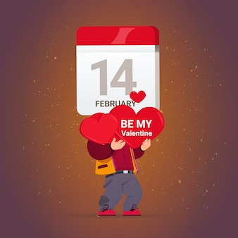 Happy valentines day greeting card man holding red hearts and calendar 14 february holiday concept