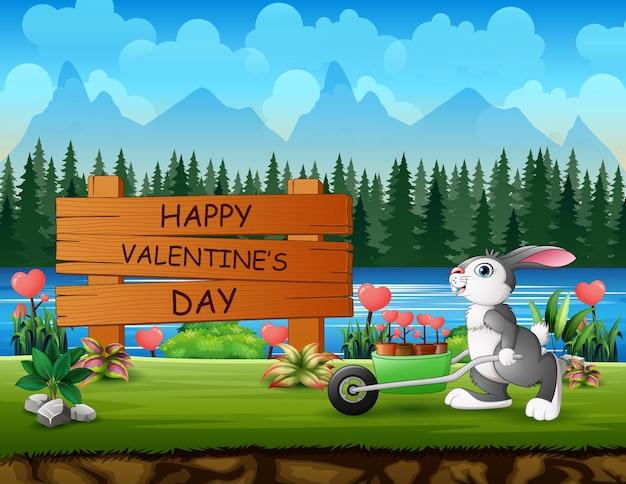 ハートの花を押すウサギと幸せなバレンタインデーのサイン
