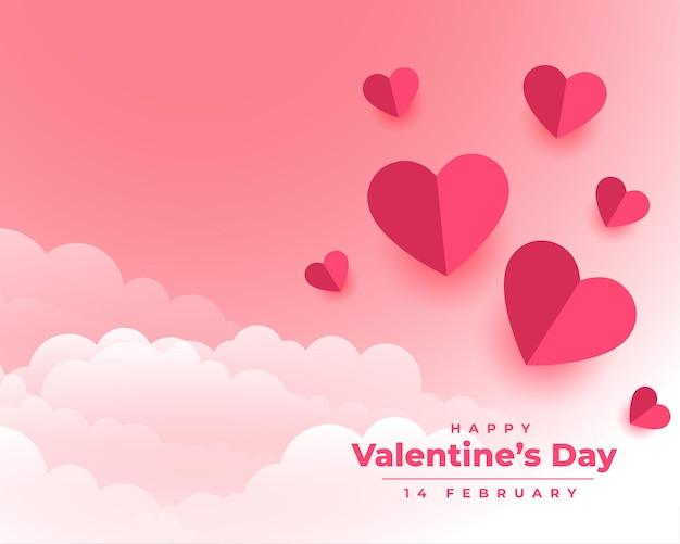 С днем святого валентина с бумажными сердечками и облаками