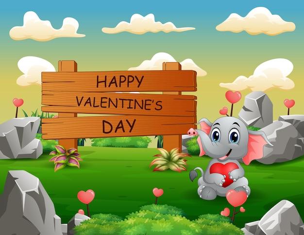 붉은 마음을 잡고 곰과 함께 해피 발렌타인 나무 기호