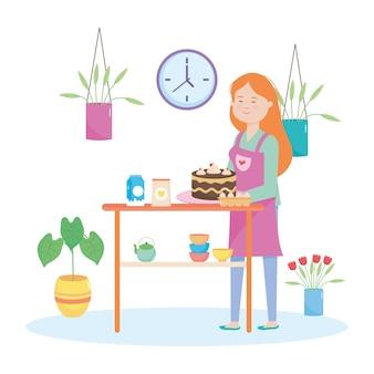白い背景の周りに植物とケーキを保持している幸せな女性