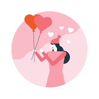 Happy woman holding heart balloons