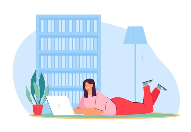 Happy woman lying on floor with laptop and working from home