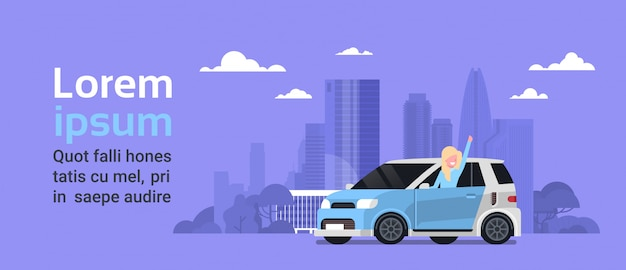Happy woman owner of new hybrid vehicle over silhouette city background with copy space