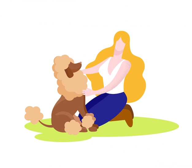 Happy woman playing with poodle dog isolated.