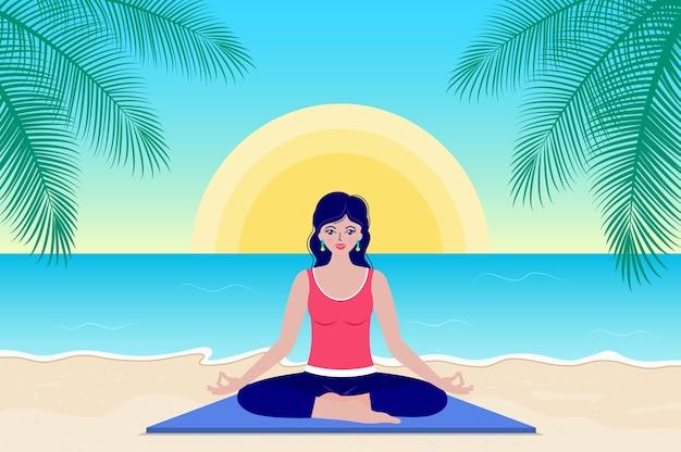 Счастливая женщина практикует йогу утром, сидя на берегу моря.