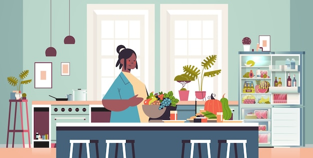 Happy woman preparing healthy food at home cooking concept modern kitchen interior horizontal portrait