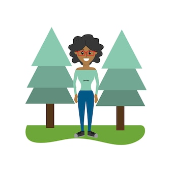 Happy woman with curly hair and pine trees