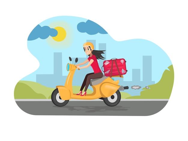 路上でスーツケースを持ってスクーターを運転する幸せな女性