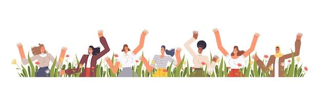 다른 국적의 행복한 여성들은 잔디와 꽃으로 손을 흔 듭니다. 봄 휴가 3 월 8 일. 흰색 배경에 고립.
