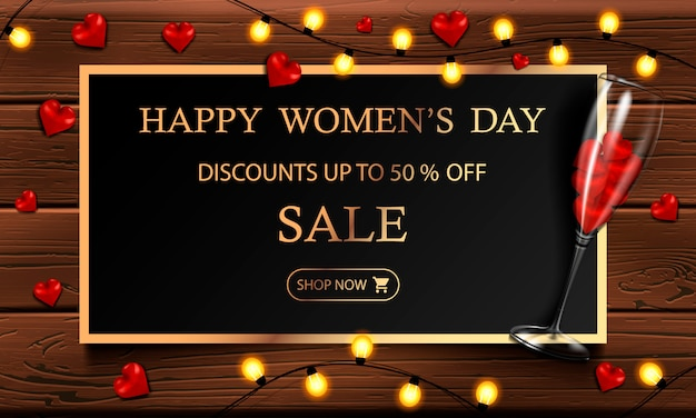 Happy women's day, march 8, horizontal postcard with a glass and hearts, yellow garland and gold frame on a wooden background for your design