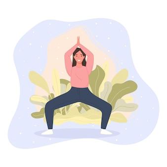 幸せな女性は床に立って、ヨガのポーズで瞑想します