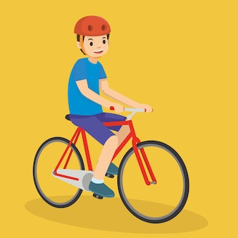 Happy young boy riding a bicycle